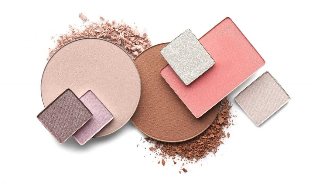 Image of makeup: eyeshadows, blush, bronzer, highlighter